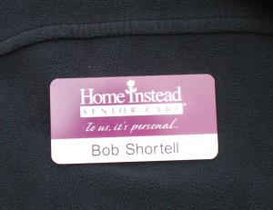 Home Instead Badge