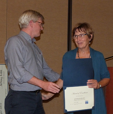 Dream Team Nurse Judith Gillen is congratulated by Care Partners CEO Andy Kyler